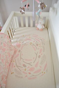 We love this spin on a woodland nursery! Light pinks, grays and whites paired with owls, deer, and other sweet little animals make the perfect woodland theme for a baby girl.