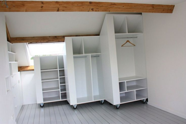 cool and clever way to save spae in a attic: a white #closet on weels which fits exactily the slope of the roof.