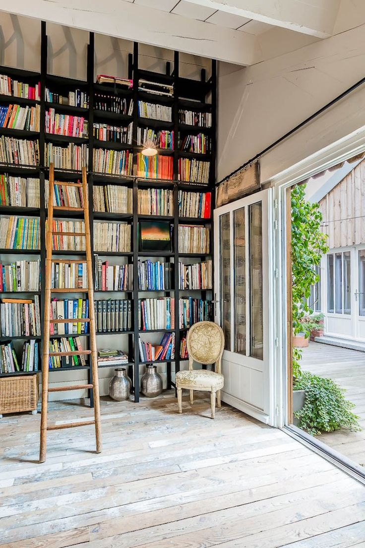 my scandinavian home: Library wall in the bright and airy Paris loft of Marika Chaumet.