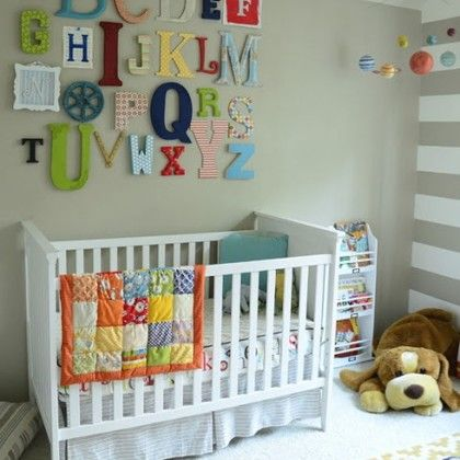 Not a huge fan of the grey walls, but I like the gallery style alphabet with lots of color and variety.