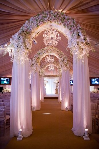 1259 best weddingsmarriage images on pinterest stage backdrops gorgeous floral and curtain wedding arch inside of the large tent for the ceremony the carpet is my least favorite however the lights on each side of the junglespirit Images