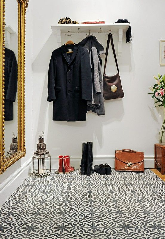 my scandinavian home: Monochromatic print tiles make quite a statement when used to define an entryway.