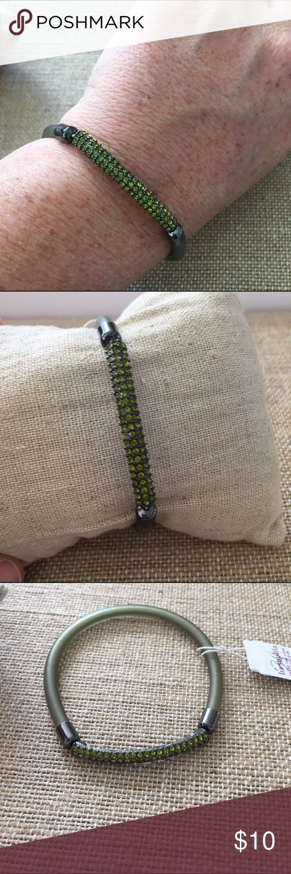Lia sophia Birthday party bracelet- Olive Stretchy bracelet with green cut crystals in the front and a jelly type material in the back. Olive green. Does not come in a lia sophia box. Lia Sophia Jewelry Bracelets