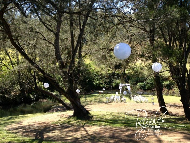 Ripples on the Creek Beautiful wedding ceremony by the creek... White paper lanterns hanging in the trees, chiffon-draped chuppah, rose petals and the sound of the creek going by. www.ripplesonthecreek.com.au