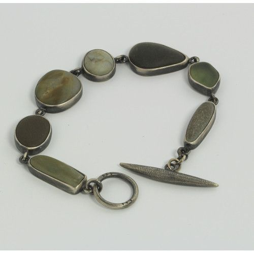 "Mini Bezel River Rock Bracelet by Terri Logan  ""...Coming from a psychological perspective, I make jewelry because of the intimacy the function allows. I use metal and stone (river rocks) because they are inherently strong materials with a rich historic value and intrinsic links to our civilization. Their abundant character, separate or in relation to each other, offers infinite possibilities as a language."" - Terri Logan $344.00"