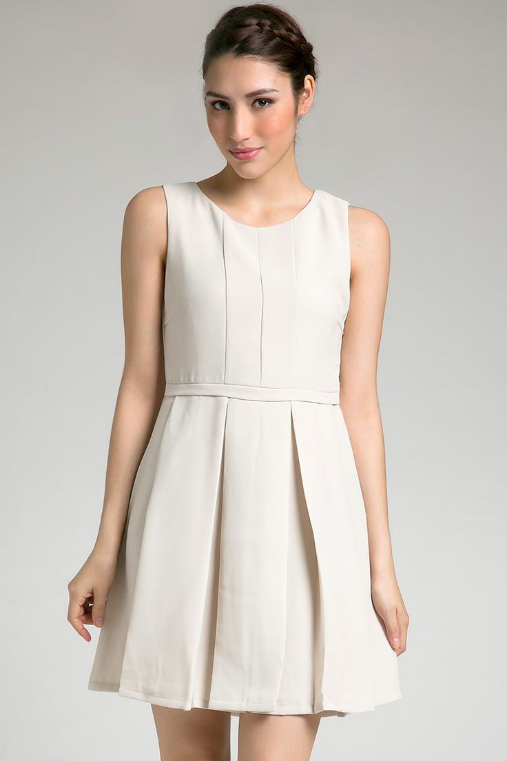 Felice Dress in white by Look Boutique. A simple dress with pleats on skirt. SImple yet stylish. Wear a necklace and complete your look with high heels. http://www.zocko.com/z/JFbcg