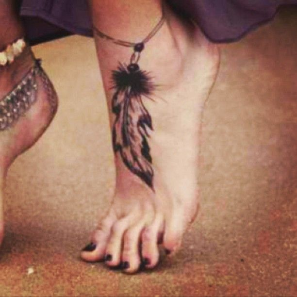 Black Ink Feather Tattoo On Girl Left Ankle