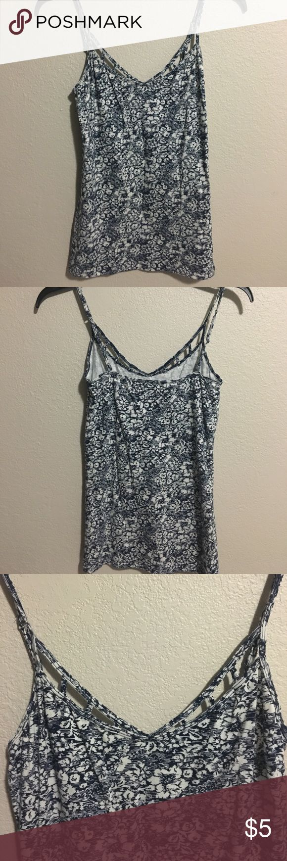 Blue and white V-neck Cami Blue and white flower patterned tank top. Has cutout front Aeropostale Tops Tank Tops