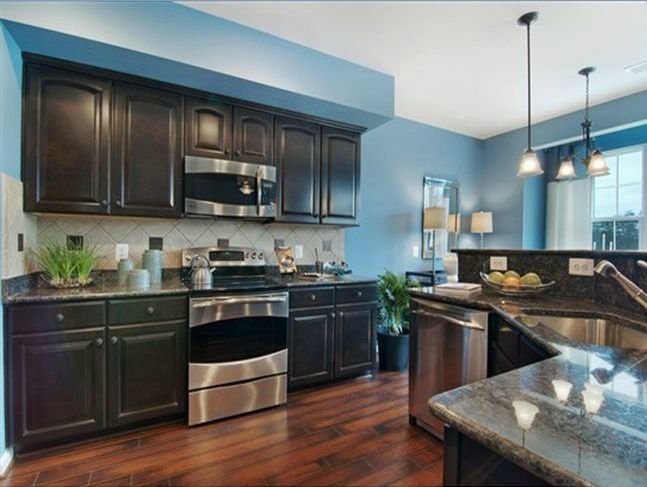 kitchen idea 1 bright blue wall dark cabinet weathered floor gray