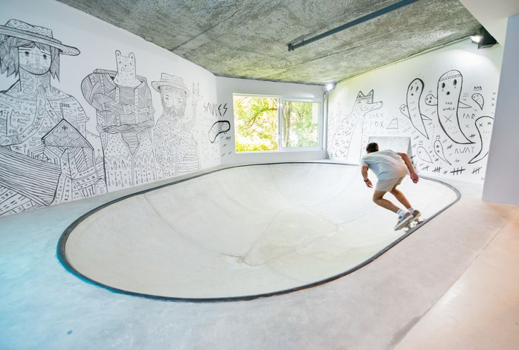 """The ultimate man cave! We converted the unused lounge area of a Cape Town residence into an industrial-inspired dream pad for the family's teenage boy and his friends. The design includes impressive design elements, such as a fully functional skate bowl, mammoth timber """"wave"""" and a four-and-a-half-metre bar!  #InhouseBrandArchitects #mancave #interiordesign #pooltable #lounge"""