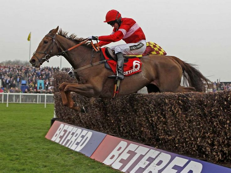 Silviniaco Conti leads Dynaste over the last to win the Betfred Bowl at Aintree.