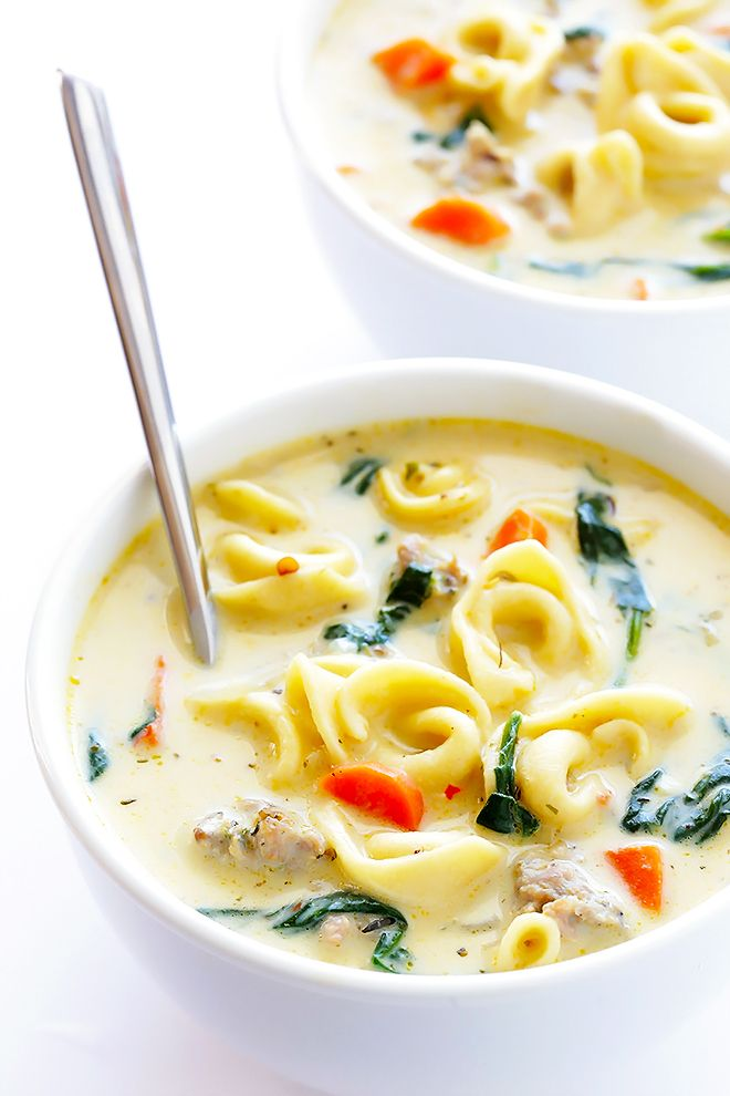 This Creamy Tortellini Soup with Italian Sausage is an absolute WINNER. It's made with a rich and creamy broth (made without heavy cream!), cheesy tortellini, zesty Italian sausage, and lots of greens and veggies. Total, delicious comfort food! | gimmesomeoven.com