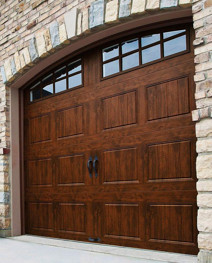 Clopay Gallery Collection 8 ft. x 7 ft. 18.4 R-Value Intellicore Insulated Ultra-Grain Walnut Garage Door with Arch Window & Best 25+ Wood garage doors ideas only on Pinterest | Painted ... Pezcame.Com