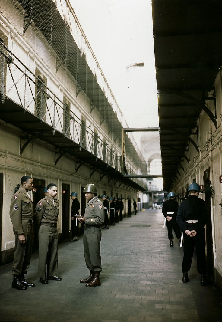 Corridor of cells in Nuremberg prison, with individual guards, which were reinforced after Robert Ley's suicide on 10/25/1945. http://historyimages.blogspot.com/2011/12/nuremberg-trials-removing-traces-of.html