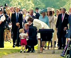 kate and william comforting george on there way to charlotte's christening poor little guy was a little overwhelmed