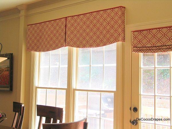 box pleat window valance on the large windows a stationary roman shade on the door