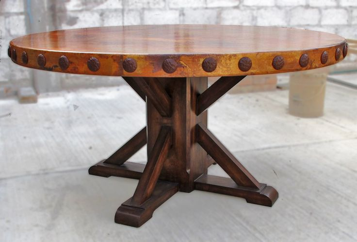 "ROUND COPPER TOP DINING TABLE: 60"" round with concha (rivet) adornment mounted on rustic, wood, pedestal table base ."