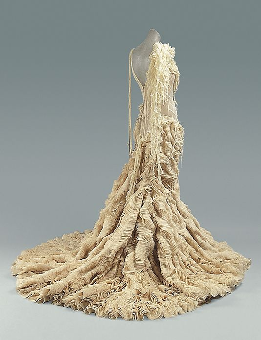 Oyster Dress  Alexander McQueen  (British, 1969–2010)    Date:      spring/summer 2003  Culture:      British  Medium:      silk  Dimensions:      Length at CB: 72 in. (182.9 cm)  Credit Line:      Purchase, Gould Family Foundation Gift, in memory of Jo Copeland, 2003  Accession Number:      2003.462