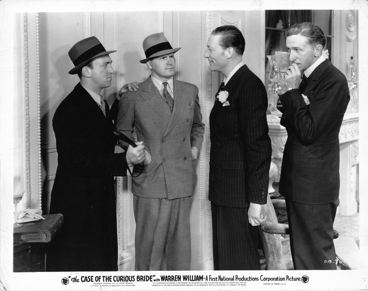 Allen Jenkins as Spudsy Drake, Warren Hymer as Oscar Pender, Warren William as Perry Mason, Olin Howland as Coroner Wilbur Strong in The Case of the Curious Bride (1935).  From the Jim Davidson Collection.