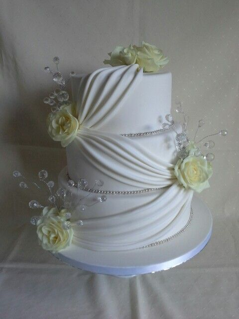 Fresh #roses,  #crystal #bling & #elegant #drapping #wedding #cake created by MJ www.mjscakes.co.nz in sunny Hawkes Bay NZ delivered to the gorgeous Mission Estate Winery