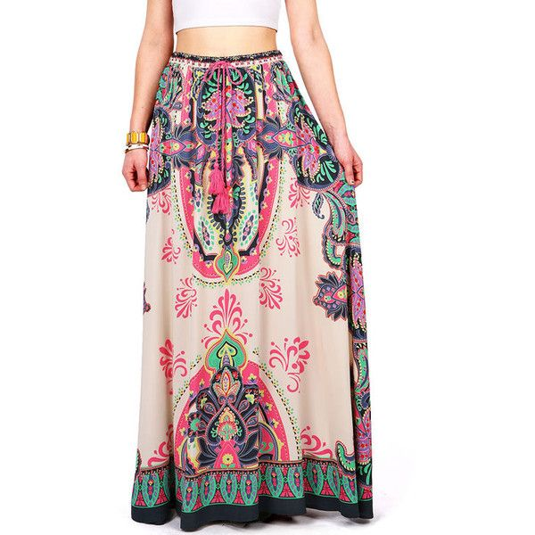 """Long statement maxi skirt with bright eastern inspired prints. Elastic waist fitting with tie strap tassels. Hand Wash Cold. 100% Rayon. 42"""" Top to Bottom. Imp…"""