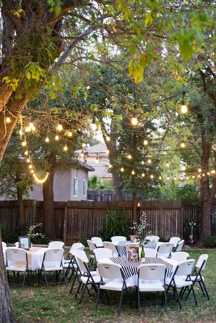 Backyard Birthday Party: Love the timeless decor and outdoor lights!