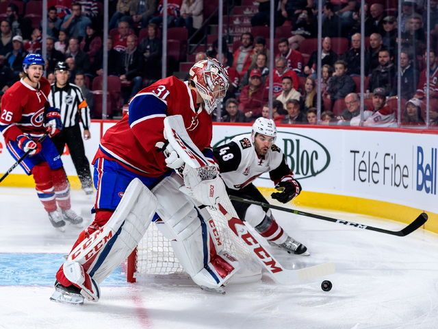 MONTREAL, QC - OCTOBER 20: Carey Price #31 of the Montreal Canadiens plays the puck near Jordan Martinook #48 of the Arizona Coyotes during the NHL game at the Bell Centre on October 20, 2016 in Montreal, Quebec, Canada.   Minas Panagiotakis/Getty Images/AFP == FOR NEWSPAPERS, INTERNET, TELCOS & TELEVISION USE ONLY ==