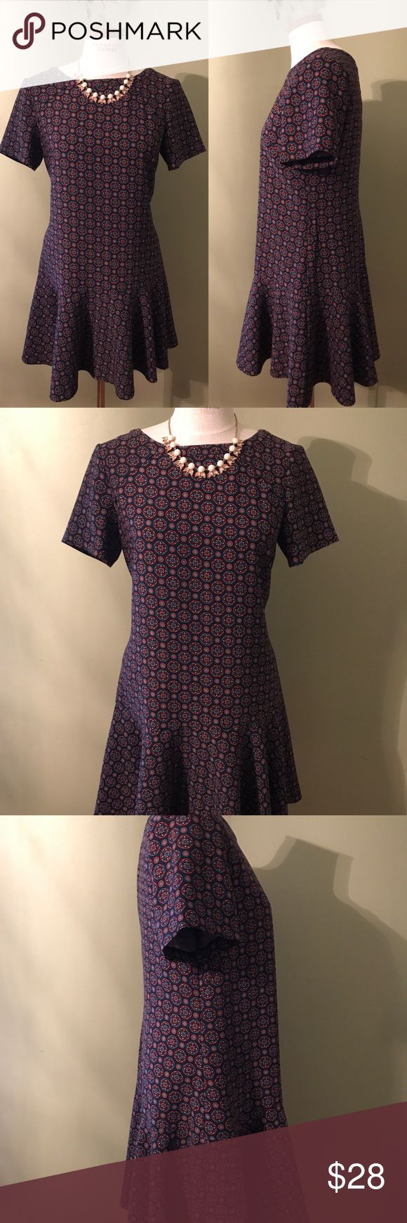 Banana Republic, US12P, professional dress Banana Republic work dress, navy blue with red/orange, light blue, white circle star patterns. Short sleeves, straight dress with peplum bottom. Great with tights and short boots for a spring meeting! Throw on an jacket and necklace for a fall night out! Banana Republic Dresses Midi