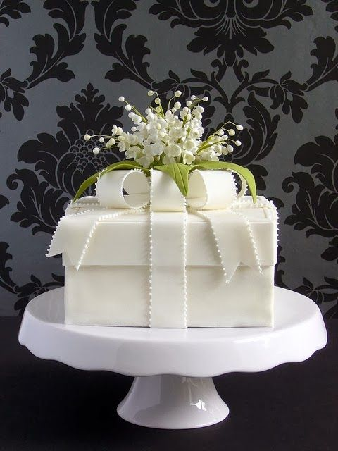 """Filed under """"less is more"""", precious, fragrant Lily-Of-The-Valley accents this simply Gift-box wedding cake.  By """"Made With Love""""  http://madewithlovebyme.wordpress.com/ - (brides)"""