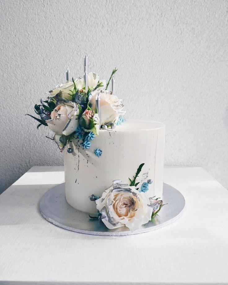 Cool tones on this amazing Anniversary cake..