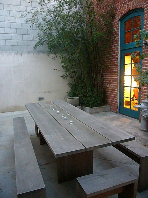 Contemporary picnic table and bench seats.