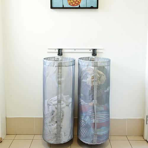 elfa Custom Washing Basket Solution. These dual Mesh Storage Bag are perfect for tidying up unruly areas of your house or outside area, sports equipment, toys and laundry are easily tidied away. They attach easily to a safety top track, utility track or directly to a wall stud. Available from Howards Storage World.