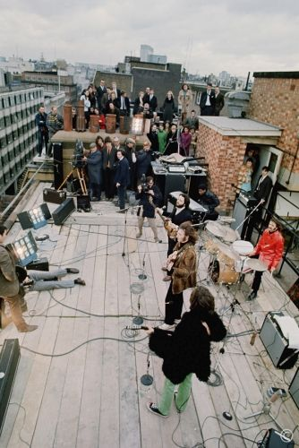 The Beatles performing on the roof of Apple Records in January 1969.  This was shot at the end of filming 'Let It Be.""