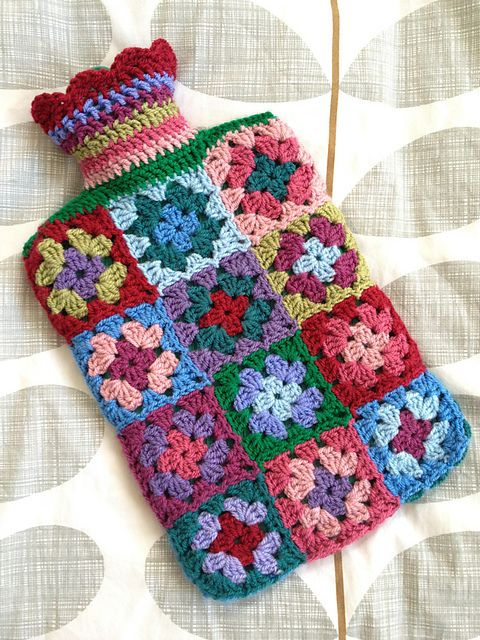 Ravelry: MsZeb's hot water bottle cover ... granny square inspiration colors ...I am certainly old enough for a hot water bottle, but I can't crochet.  This is pretty and colorful.
