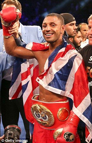 Kell Brook poses with his belt and flag after getting the decision over Shawn Porter