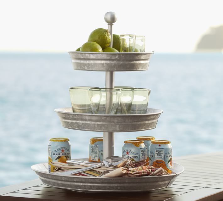 Recognized for its rustic character as much as its function, galvanized iron has visible crystallites on the surface that create a distinctive aesthetic appeal. Perfect for casual entertainment indoors or out, our tiered stand presents your favorite beverages, condiments and tabletop accessories with style.