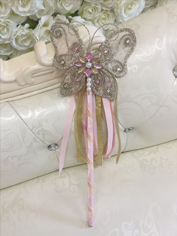 Pretty pink and gold ribbon wands to delight the flower girl who wants something a bit different