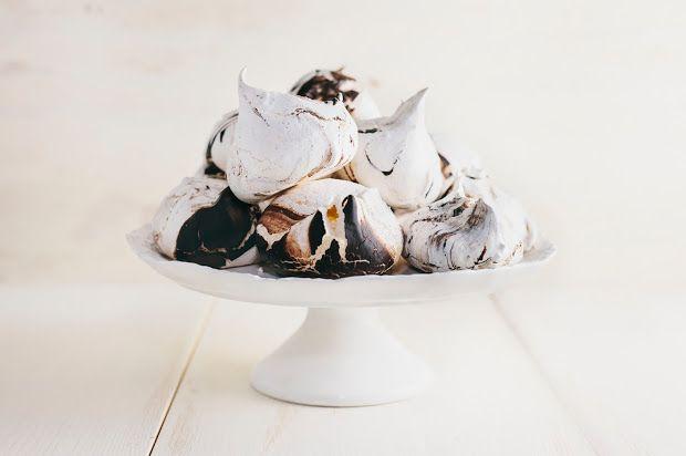 A recipe for orange blossom meringues with a dark chocolate swirl.