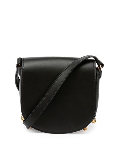 "Alexander Wang smooth leather saddle bag. Golden hardware. Crossbody strap; 21"" drop. Studs trim bottom of body. Exterior back slip pocket. Flap top closure. 6.5""H x 6.7""W x 3.2""D. ""Lia"" is imported."