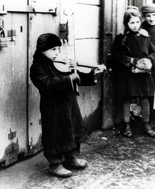 """"""" a jewish boy playing a violin to support himself in the warsaw ghetto, poland, february 1941 photo by galerie bilderwelt and joe j. heydecker """""""