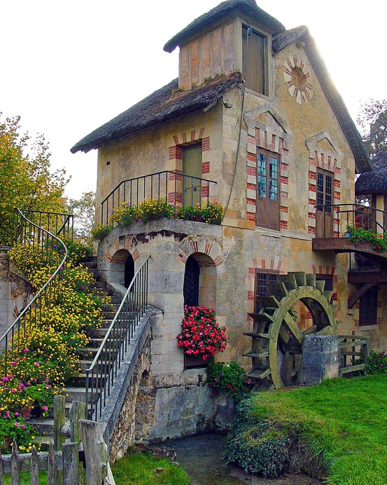 Rear view of the Moulin, the watermill cottage built for Marie Antoinette as an extension of the Petit Trianon, on the grounds of Versailles Palace. Although King Louis had the Petit Trianon built for his wife in 1774, it became associated with Marie Antoinette's perceived extravagances & excesses.