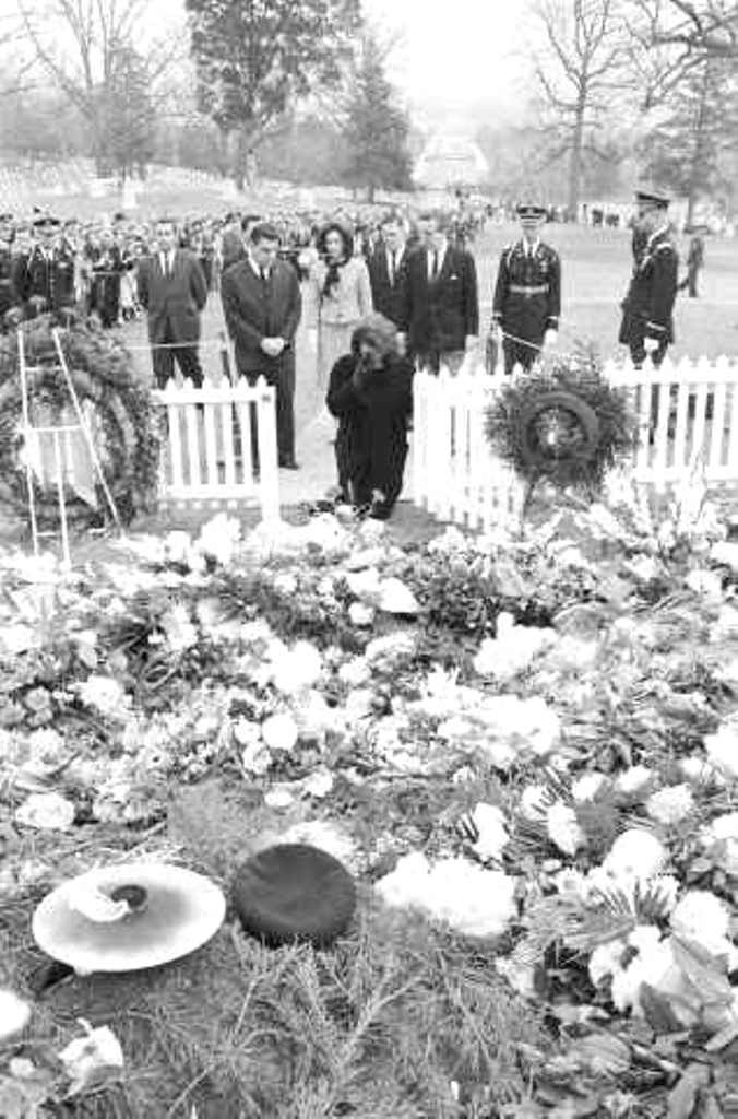 Jackie Kennedy Visiting President's Grave Jackie Kennedy wipes tears away as she kneels at the grave of her late husband, on November 28, 1963. Behind her at the Arlington National Cemetery are Princess Lee Radziwill, her sister; Press Secretary Pierre Salinger, and White House staff John McNally  Date Photographed:November 28, 1963.❤                      .................................RIP