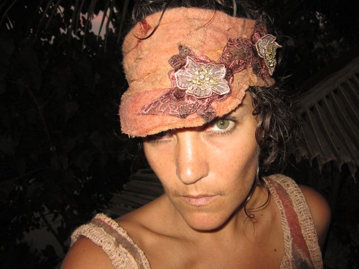 Hand dyed peach felt visor with flower decal.  Wet felted with love and sass.