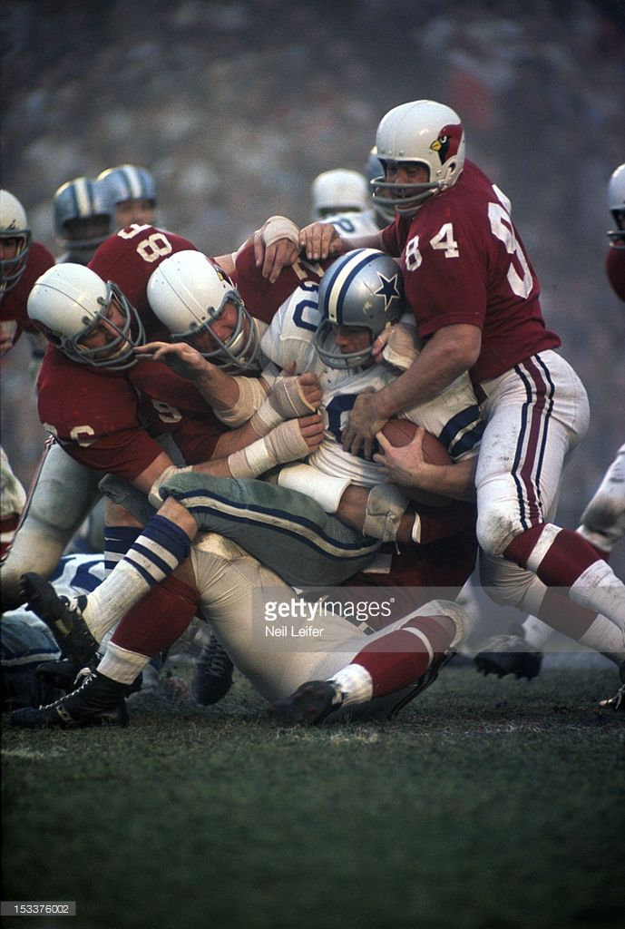 Dan Reeves finds rough going with the St. Louis Cardinals defense in 1966.
