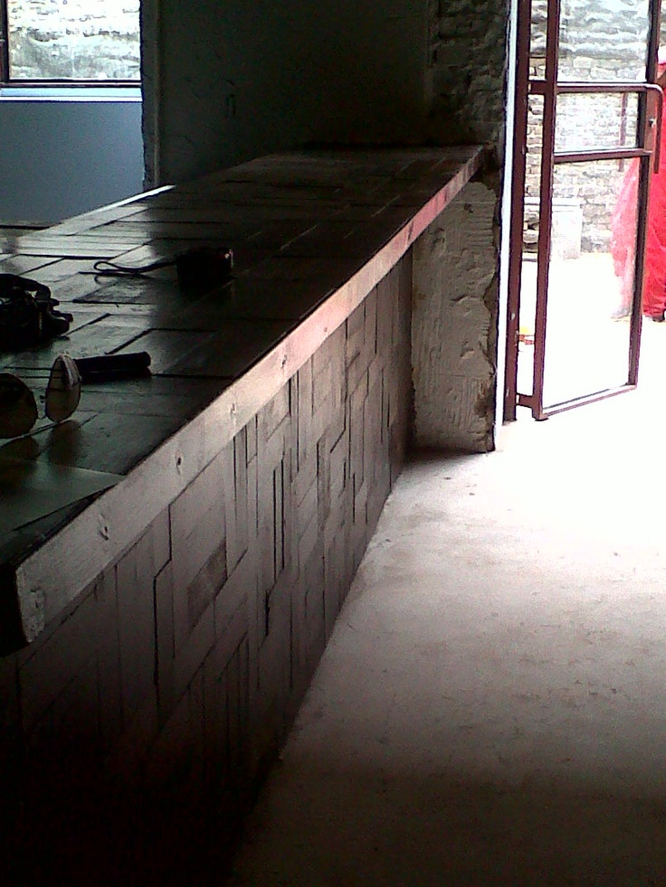 reclaimed floor becomes bar counter.
