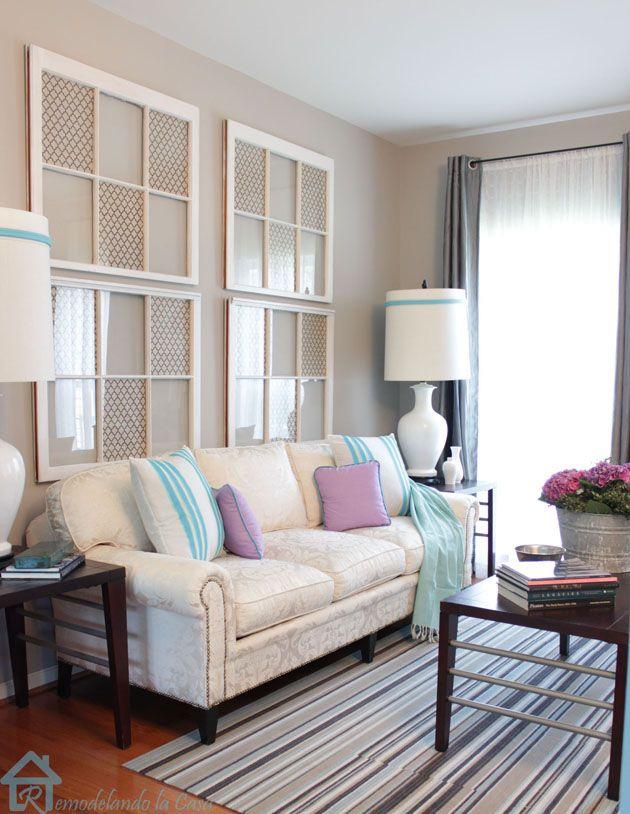 Easy Sofa Makeover:  Great coastal vibe; love the up cycled wall art.  You could also make it  into a photo wall gallery by attaching photo's to back of glass.  Love the color palate too.