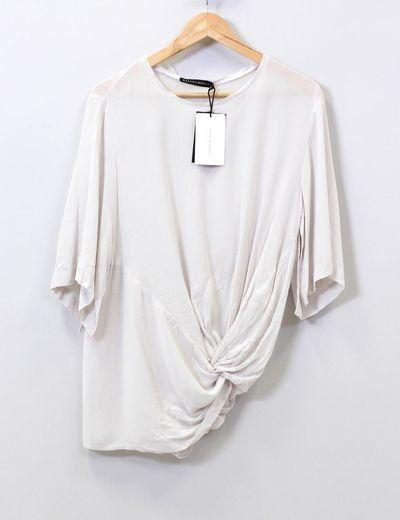 Blusa asimétrica nudo  Zara