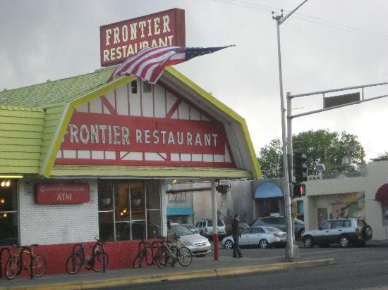 "Albuquerque NM: The road passes the University of New Mexico; if you're hungry (and if you can find a parking place, which is tough), stop at the Frontier Restaurant, a classic student dive across from campus, and order a Fiesta Burger. About half the population of New Mexico has had one at one time or another, and it'll seem like they're all in line ahead of you, but that's the way ""local color"" works."