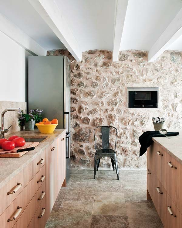 Mediterranean Villa Gets In Touch With Nature Through A Stone Facade