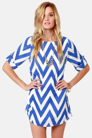 Can You Zig It? Blue Chevron Print Dress: Silky woven material forms the perfect shift shape, with a captivating zigzag print in bright periwinkle blue and white. Short, cuffed sleeves are topped with lovely faux pearl and gold button-tabs for a polished finish. Boat neckline. Dress is lined. 100% Polyester. Hand wash cold or dry clean. $46